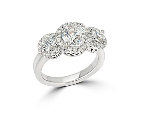Platinum and diamond engagement ring with 3 large diamonds accented with smaller stones.