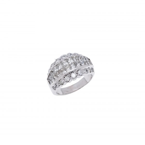 18Kt Illusion Set Princess Cut and Round Brilliant Cut Diamond Celebration Ring